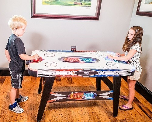 Kids Playing on Triumph Fire 'n Ice LED Light-Up Air Hockey Table