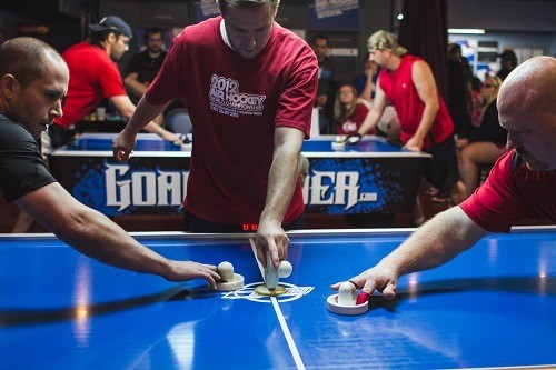 Professional Air Hockey Players in a Match