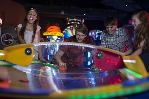 Teens Having Fun with Air Hockey